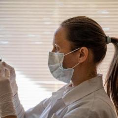 Female medical professional preparing a vaccination